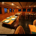 Dining area on MV Pinditio - Coral Triangle Adventures