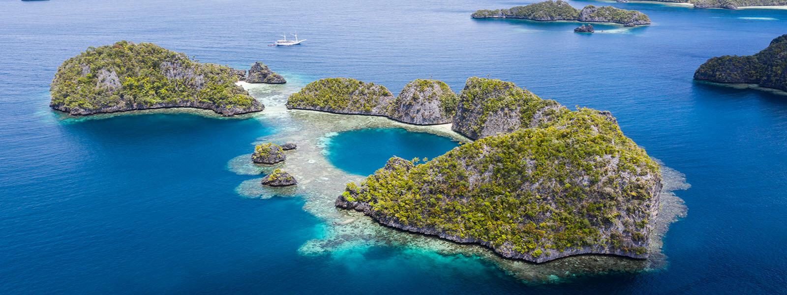 We snorkel the reefs around the limestone islands of Msiool, Raja Ampat